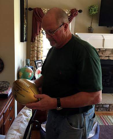 He received a Super Bowl football and helmet